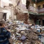 A dumping ground near a dilapidated building in Marrakech Medina