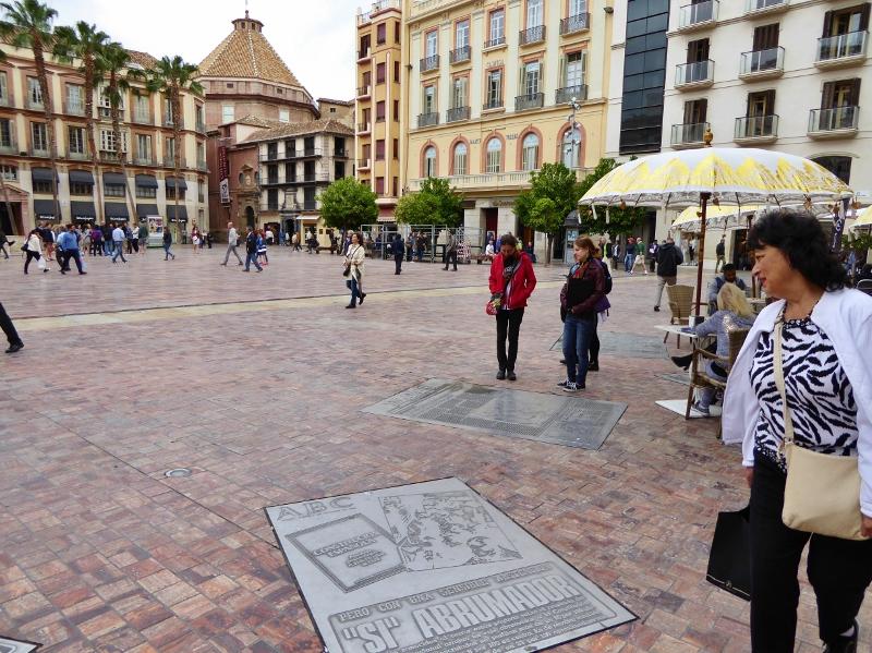 Devour Malaga Food Tour - plaques in the ground surrounding Plaza Constitución.