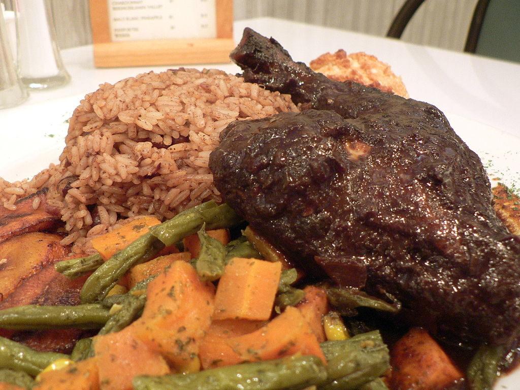 yummy Jamaican jerk chicken 1024px-Jerk_chicken_plate. By stu_spivack (jerk chicken) [CC BY-SA 2.0 (http://creativecommons.org/licenses/by-sa/2.0)], via Wikimedia Commons