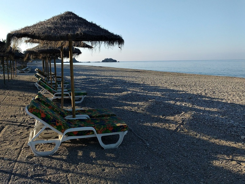 Beach chairs and umbrellas ready to start the day on San Cristobal Beach Almunecar